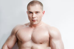 Athletic powerful person. Perfect body of young handsome man. Athletic powerful person, cool boy, sweaty wet skin glossy effect, prepares flawless body for Stock Photography