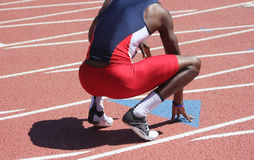 Athletic runner rests after race Royalty Free Stock Image