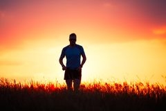 Athletic runner at the sunset stock photo