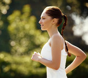 Athletic Runner Training in  a park for Marathon. Fitness Girl R Stock Images