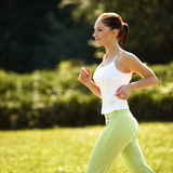 Athletic Runner Training in a park for Marathon. Fitness Girl Ru Stock Photo