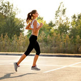 Athletic Runner Training in a park for Marathon. Fitness Girl Ru Royalty Free Stock Photography