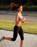 Athletic Runner Training in a park for Marathon. Fitness Girl Ru Stock Photography
