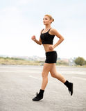 Athletic Runner Training in a park for Marathon. Fitness Girl Stock Photography