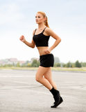 Athletic Runner Training in a park for Marathon. Royalty Free Stock Photo