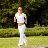 Athletic Runner Training in a park for Marathon. Fitness Girl Stock Images