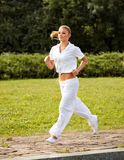 Athletic Runner Training in a park for Marathon. Fitness Girl Stock Photo