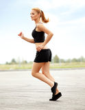 Athletic Runner Training in a park for Marathon. Fitness Girl Stock Photos