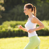 Athletic Runner Training in a park for Marathon. Fitness Girl Royalty Free Stock Image