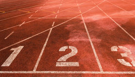 123 on an athletic running track lane. Royalty Free Stock Images