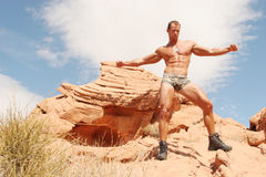 Athletic sexy body builder. Sexy muscular body builder in shorts Stock Photography