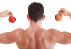 Athletic sexy male body builder holding red apple Royalty Free Stock Image