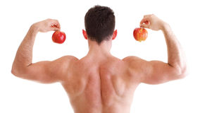 Athletic sexy male body builder holding red apple Royalty Free Stock Photos