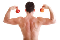 Athletic sexy male body builder holding red apple Stock Photography