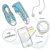Athletic shoes and cell phones and coffee Royalty Free Stock Image