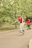 Athletic skilled young girl roller skating Stock Image