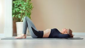 Athletic slim fitness young woman pumping press enjoying workout exercise at gym. Full shot. Sports female having perfect slim body lying on mat during healthy stock footage