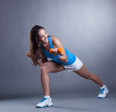 Athletic smiling model exercising with dumbbells royalty free stock photos