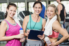 Athletic smiling women discussing about performance. In crossfit Royalty Free Stock Photo