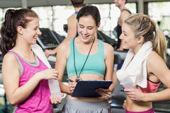 Athletic smiling women discussing about performance. In crossfit Royalty Free Stock Image