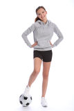 Athletic soccer player teenage girl foot on ball. Athletic soccer player teenage girl with happy smile wearing sports clothes, standing in casual pose with a Royalty Free Stock Photography