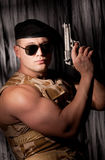 Athletic soldier with handgun Royalty Free Stock Images