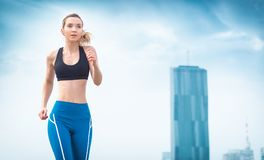 Athletic sport woman running and jogging Stock Images