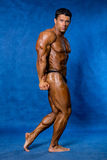 Athletic sports bodybuilder demonstrates posture Stock Photos