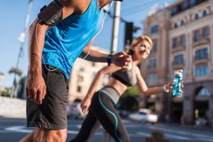 Sportswoman and sportsman jogging in city Royalty Free Stock Images