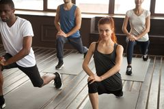 Sporty diverse people doing lunge forward exercise at group trai Royalty Free Stock Photo