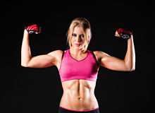 Athletic strong young girl Stock Photography
