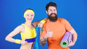 Athletic Success. Sporty couple training with fitness mat and jump rope. Happy woman and bearded man workout in gym stock photography