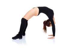 Athletic supple woman arching her back Royalty Free Stock Photos