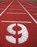 Athletic Surface Markings - Number Nine. Athletic Surface Markings in bright colors, using crumb rubber Stock Photos