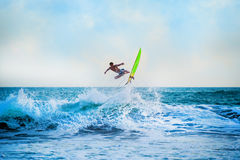 Athletic surfer with board Stock Photo