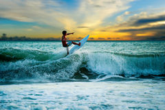 Athletic surfer with board Stock Photos