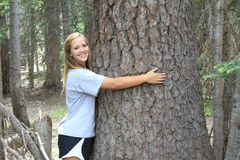 Athletic Teen Hugging Tree Royalty Free Stock Images
