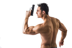Athletic Topless Man Holding Handgun Against White Royalty Free Stock Photo