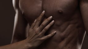 Athletic torso and woman hand Stock Footage