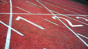 Athletic track. Starting line of the athletic running track Royalty Free Stock Image