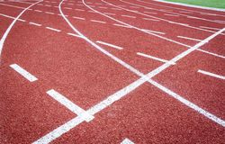Athletic track. A deserted athletic running track in a green field stock image