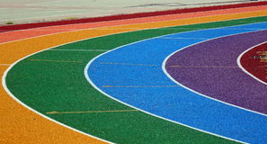 Athletic Track Markings. Running tracks in several bright colors with white lane markings Royalty Free Stock Photo