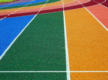 Athletic Track Markings. Running tracks in several bright colors with white lane markings Royalty Free Stock Images