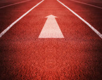 Athletic Track or Running Track with an arrow pointing good for Stock Images