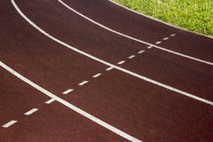 Athletic track on the stadium. Stock Photo