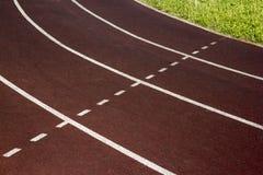 Athletic track on the stadium. Stock Photo