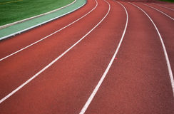 Athletic track. The white deviding lines on a running track Royalty Free Stock Photos