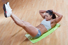 Athletic trainer show exercises in the gym. Beautiful athletic trainer shows examples of exercises in the gym Stock Photo