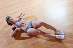 Athletic trainer shows examples of exercises Stock Photo