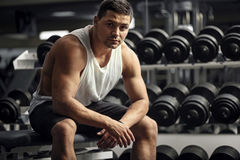 Athletic well built man sitting in a gym stock photos